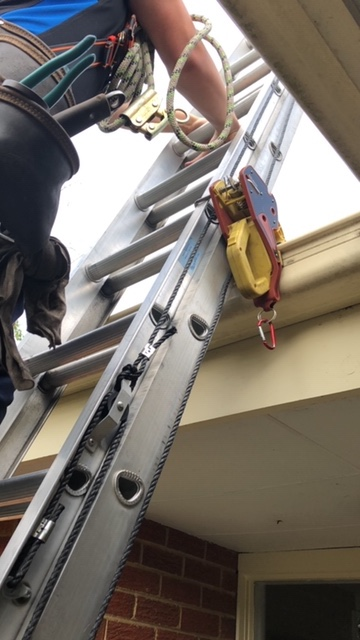 Tradesman using Lock Jaw Ladder Grip - Ladder Safety