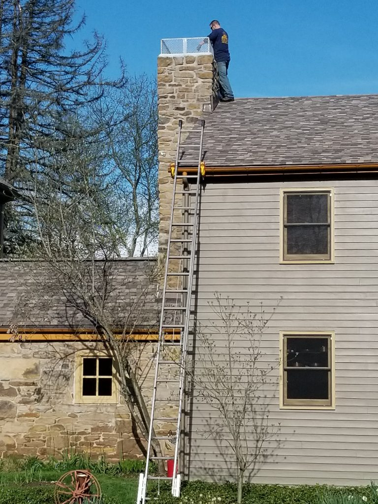 Lock Jaw Ladder Grip being used on a 1795 Farm house to stabilise a ladder